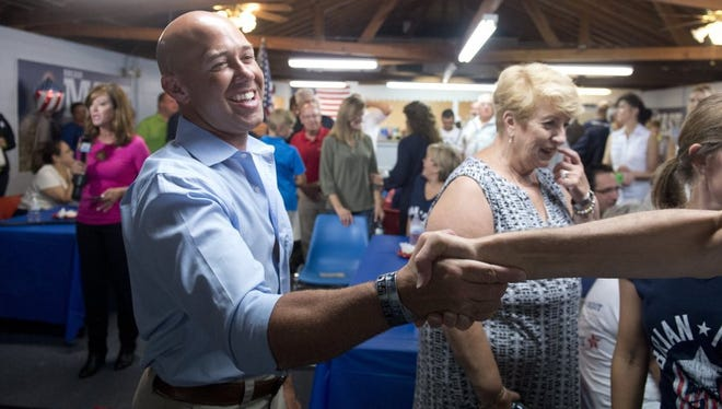 Images from Brian Mast's election party Tuesday at the Palm City Civic Center in Palm City. Mast won the Florida Congressional District 18 Republican primary race, defeating Carl Domino, Mark Freeman, Rick Kozell, Noelle Nikpour and Rebecca Negron.