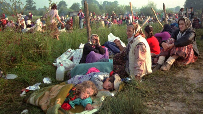 Refugees from Srebrenica who had spent the night in the open air, gather outside the U.N. base at Tuzla airport in this July 14, 1995, file photo. Toward the end of Bosnia's 1992-95 war, as many as 8,000 Bosnian Muslim men and boys were killed when Bosnian Serb troops overran the eastern Bosnian enclave of Srebrenica July 11, 1995. It was Europe's worst mass killing since World War II.