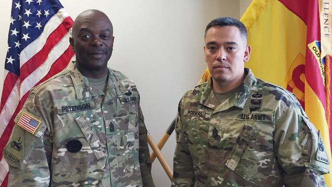 Special Troops Battalion, 1st Armored Division Sustainment Brigade recently had a change in its top enlisted leaders. Command Sgt. Maj. Ernest S. Peterson, left, gave up his position and was succeeded by Command Sgt. Maj. Jason C. Porras.
