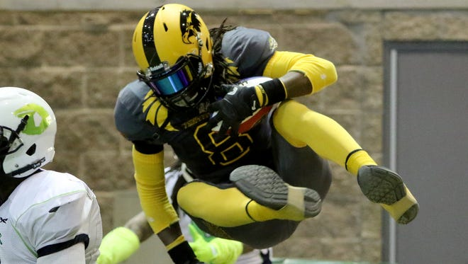 Wichita Falls Nighthawks' Demarius Washington leaps over the wall in the game against the Nebraska Danger Friday, May 5, 2017, in Kay Yeager Coliseum. The Nighthawks defeated the Danger 57-40.