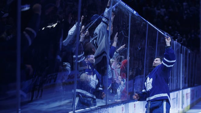 Toronto goaltender Michael Hutchinson gives his stick to fans as he's named the first star.