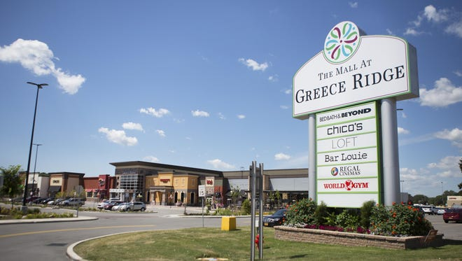 A new sign lists stores and restaurants in a newly construction area of The Mall at Greece Ridge.