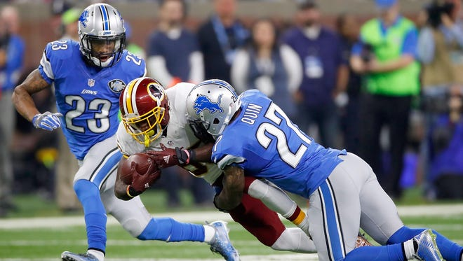 Lions safety Glover Quin tackles Washington's Jamison Crowder during the Lions' 20-17 win Sunday, Oct. 23, 2016. Quin signed with the Lions in 2013.