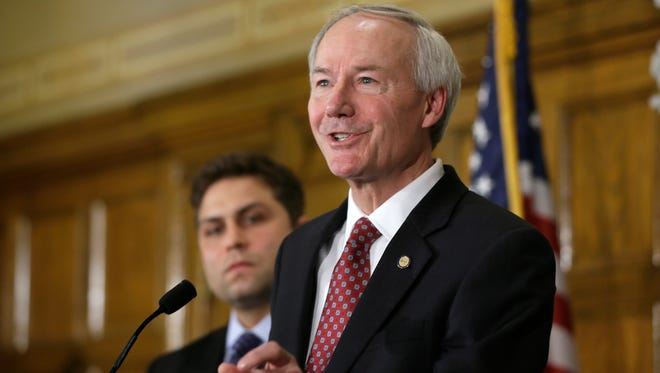 Arkansas Gov. Asa Hutchinson answers questions from reporters at the state Capitol in Little Rock on Wednesday. On the day he was expected to sign House Bill 1228 into law, Hutchinson did an about-face and called for changes to the state's religious objection measure while facing a national backlash from businesses and gay rights groups.