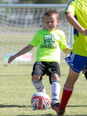 Gavin Strascina, 6, participates in the Challenger British Soccer Camp on Thursday, May 31, 2018,  at High Noon Soccer Complex.