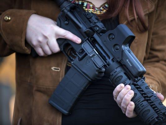 FILES-US-CRIME-SHOOTING-JUSTICE-GUNS