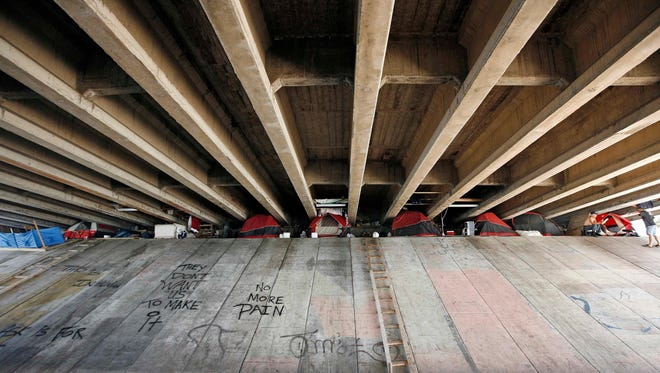A  makeshift camp of sex offenders under a bridge  in Miami is seen in 2008.