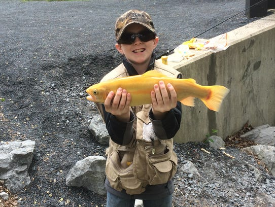 Chase Beidel, 10, caught a 19-inch palomino in the