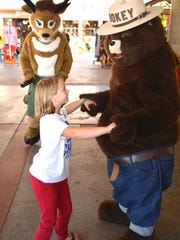 "Serena Cannon dances ""the Swing"" with Smokey Bear at the 4th annual Get Outdoors Day at the Tuacahn Amphitheatre."