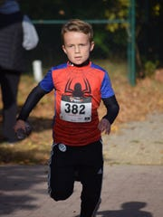 Lance Creighton, 9, of Pittsgrove stays focused as he approaches the 5k finish line during the Halloween Bone Run & Walk at Parvin State Park. Proceeds from the event benefit the United Way of Greater Philadelphia and Southern New Jersey.