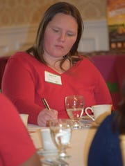 Jamie Warner of Bridgeton, a Development and Marketing associate at the Bayshore Center at Bivalve takes notes during the Marketing and Financing Main Streets Through the Heartland luncheon at Tomasello Winery in Hammonton on Wednesday, March 9. Photo/Jodi Streahle