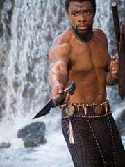 """Chadwick Boseman plays T'Challa/Black Panther in """"Black Panther,"""" which opens in Utah theaters Friday."""