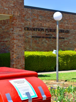 A red book drop at Champion Public Library is taped shut Thursday. While Southern Oklahoma Library System branches have extended due dates until further notice, classes and storytimes have been added to their Facebook page.