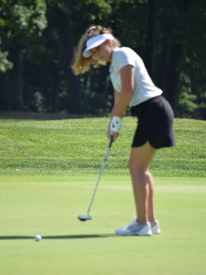 Delaney DiGeronimo putts the ball toward the hole last fall. The Hudson girls golf team finished second in the Suburban League National Conference standings in 2019.
