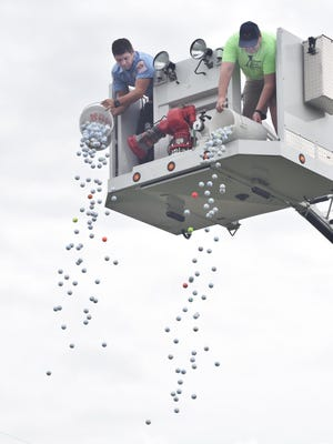FILE PHOTO: About 600 golf balls were dropped last year from the Kewanee Fire Department's aerial ladder truck as part of a fundraiser for the Kewanee Animal Shelter. Henry County Humane Society/Kewanee annual Shelter will hold the second annual golf ball drop fundraiser at 1 p.m. Oct. 3 at the Baker Park Driving Range.