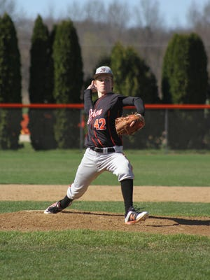 Cam Miller, featured in this week's Senior Spotlight (During a pandemic) gets set to release a pitch while throwing for the Byron Tigers.