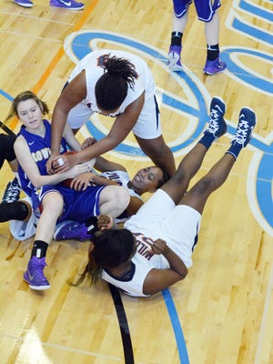 Louisiana College's Brooke Jones (54, top right), Anna Phillips (24, right center) and Briana Harris (35, bottom right) try to get the ball away from Hardin-Simmon's Danie Mabry (14, left) Saturday, Feb. 7, 2015.
