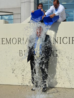 Woodbridge Mayor John McCormac takes the ALS Ice Bucket Challenge on Friday at the township's Municipal Building. Hey, Mayor, no T-shirt and shorts?