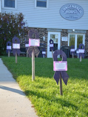 Thirty-nine wooden ribbons stand in the VIP front yard to remember those who were lost in Wisconsin last year, and 136 ribbons hang on a tree to commemorate victims of domestic violence who were served in Kewaunee County last year. These will stay visible through October for Domestic Violence Awareness Month.