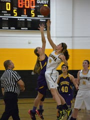 Algoma's Anna Dier and Kewaunee's Abby VanGoethem tip off the first War on the Shore game of the season.