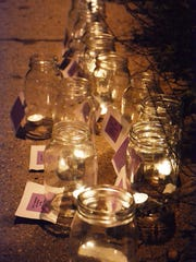Candles were lit on Oct. 14 at a VIP-sponsored event for the victims who died as a result of domestic abuse in 2013 in Wisconsin.