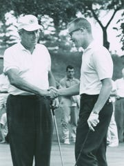 Don Stevens, right, accepts congratulations from runner-up Tom Draper Jr. as he wins the 1960 Michigan Amateur Championship.