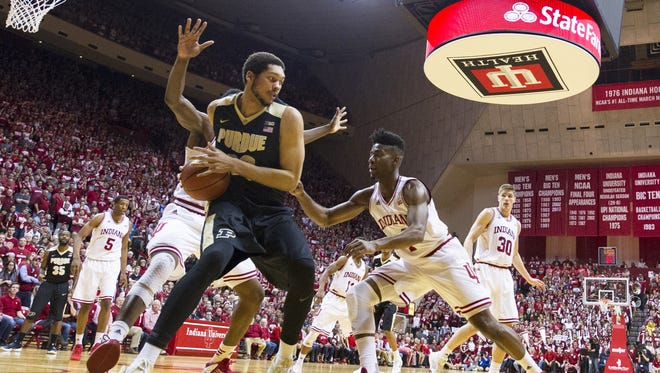 Purdue Boilermakers center A.J. Hammons (20) tries to move the ball off the baseline as he's trapped by Indiana Hoosiers guard Robert Johnson (4) during the first half of an NCAA men's college basketball game at Indiana University's Assembly Hall in Bloomington, Ind., Saturday, Feb. 20, 2016.