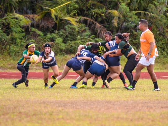 In this Jan. 27 file photo, the Academy of Our Lady of Guam play John F. Kennedy High School in a IIAAG Girls High School Rugby League match at Okkodo High School.
