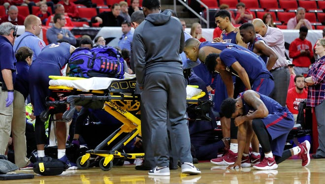 South Carolina State players react as Ty Solomon is attended to after he was injured during the first half of an NCAA college basketball game against North Carolina State at PNC Arena in Raleigh, N.C., Saturday, Dec. 2, 2017.
