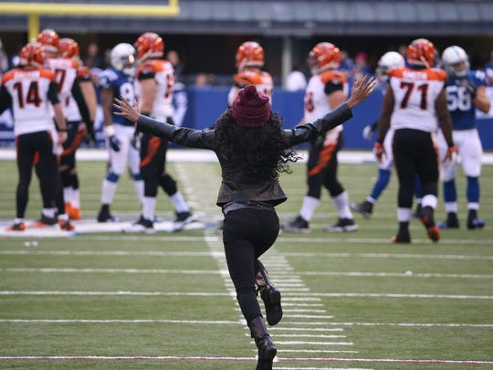 A fan races on to the playing field in the fourth quarter heading towards Bengals and Colts players.