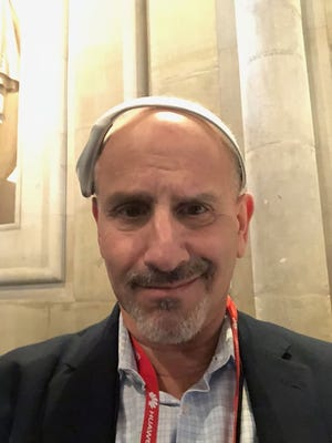 Ed Baig wears Modius weight loss headset during Mobile World Congress in Barcelona on Feb. 25.