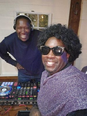 Angel Robinson Jr. (DJ Angel), left, and Jonathan Thompson (The Host JT) put on virtual dance parties -- with costumes -- from Cape Cod every Friday night. They spin the hits from the disco era, '80s and '90s for hundreds of fans from around the world.