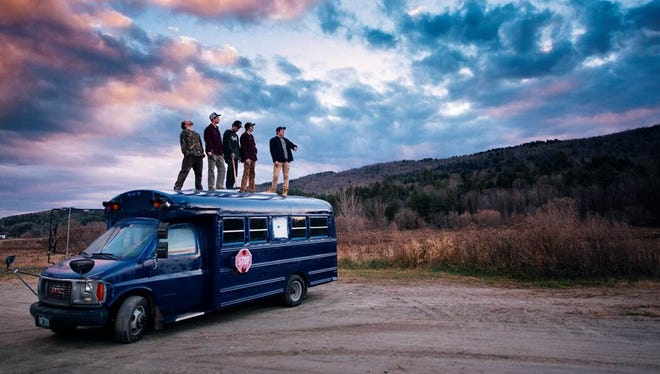 Members of the University of Vermont stand atop the NOTION, the 2002 GMC micro bus that was converted into a mobile headquarters for a 6,000-mile western ski trip this winter. From left are: Tim McClellan, Jack Goodwin, Evan Booth, Brooks Curran, and Andrew Levin.