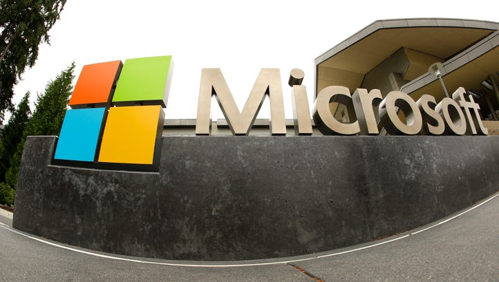 FILE - This July 3, 2014, file photo, shows the Microsoft Corp. logo outside the Microsoft Visitor Center in Redmond, Wash. Microsoft reports financial results Tuesday, July 19, 2016. (AP Photo Ted S. Warren, File) ORG XMIT: NYBZ204