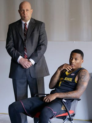 Arizona State coach Herb Sendek and player Jahii Carson wait to answer questions during the Pac-12 NCAA college basketball media day.