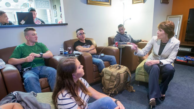 Former U.S. Rep. and Florida gubernatorial candidate Gwen Graham, right, chats with sailors and Marines in the lounge at the USO Pensacola International Airport on Tuesday, April 10, 2018.  Graham was spending the day volunteering at the USO.
