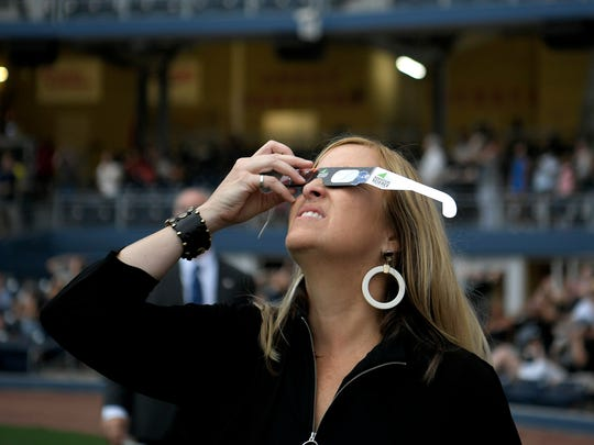 Nashville Mayor Megan Barry watches the eclipse at Nashville's eclipse-viewing party at First Tennessee Park Monday, Aug. 21, 2017 in Nashville, Tenn.