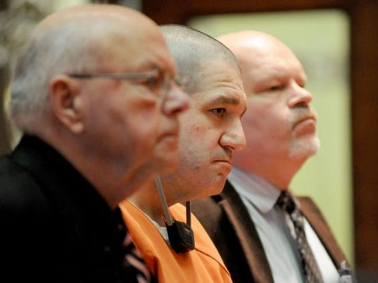 Flanked by attorneys Robert Whitney and R. Rolf Whitney, Donald Hoffman, 41, pled guilty to four counts of murder and was sentenced to four consecutive life sentences Wednesday in an emotional hearing in which family members addressed Hoffman in Judge Russ Wiseman's courtroom in Bucyrus.
