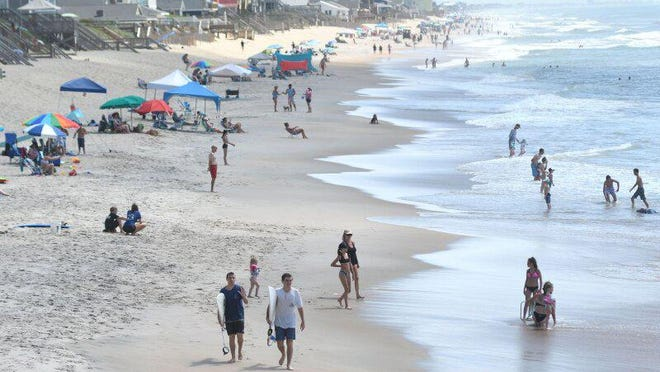 Crowds fill the beach to the north of Surf City Ocean Pier in Surf City, N.C., Wednesday, June 24, 2020. Several business owners said that it was busier this year than previous years.