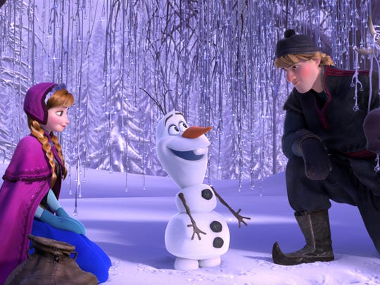 Olaf, seen here with Anna and Kristoff in Disney's 'Frozen,' will not show up in Danielle Paige's 'Stealing Snow.'