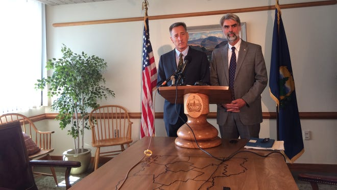 Gov. Peter Shumlin, left, and Administration Secretary Jeb Spaulding announce Thursday that revenues coming into the state are expected to increase 3 percent instead of the 4.8 percent expected when legislators and the governor built the 2015 state budget. That will require cutting 2 percent in spending, Shumlin said.