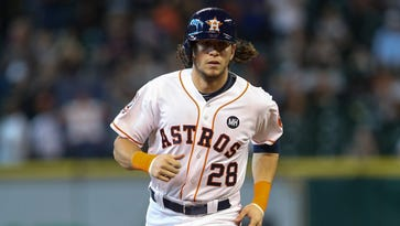 Colby Rasmus rounds the bases after hitting his second