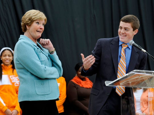 Tyler Summitt shares a laugh with his mother, Lady Vols coach emeritus Pat Summitt, during the unveiling of a sculpture of Summitt on campus Nov. 22, 2013.