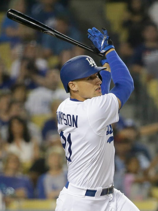 Los Angeles Dodgers' Trayce Thompson watches his home run against the Atlanta Braves during the fifth inning of a baseball game in Los Angeles, Friday, June 3, 2016. (AP Photo/Chris Carlson)