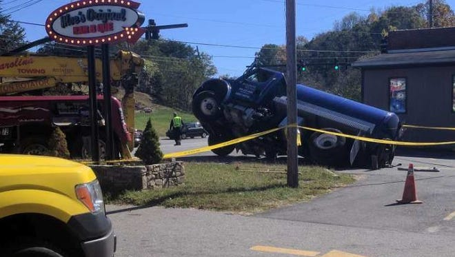 A sinkhole Friday in Woodfin swallowed part of a small tanker truck.