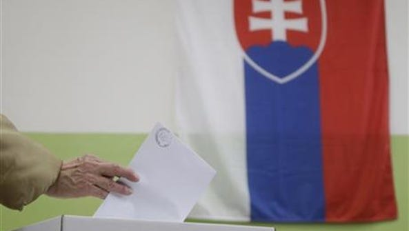 A woman casts her vote during general elections in
