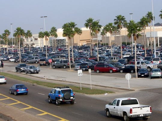 Shoppers pack the parking lot of the Shops at La Palmera