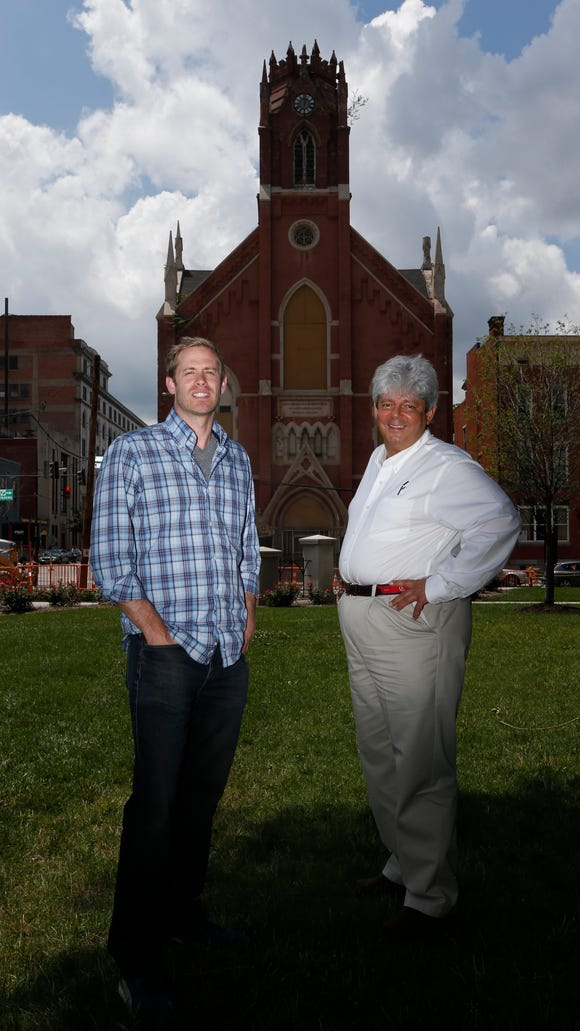 Josh Heuser, left, and Michael Forgus of Transept Property LLC are transforming the old St. John's church in Over-the-Rhine into an event center.