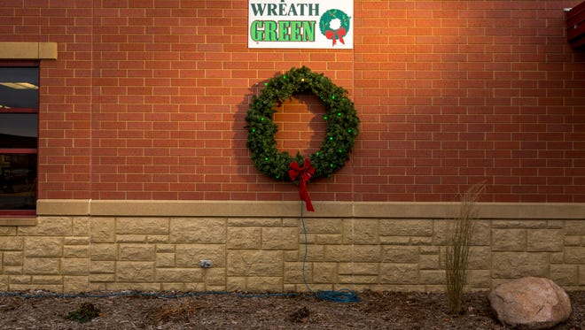 The Marshfield Fire Department hangs a wreath outside the station as a way of keeping record of the number of structure fires in the county from Thanksgiving through New Year's Eve.
