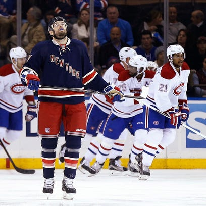 Rangers left wing Rick Nash reacts after a goal by